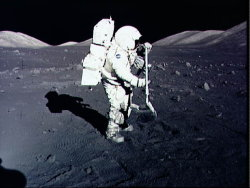 Astronaut and geologist Harrison Schmitt collects samples on the Moon