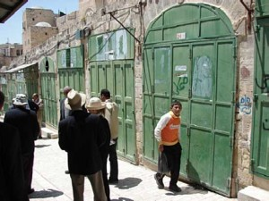 Arab shops in the center of Hebron blow-torched shut by Israeli forces
