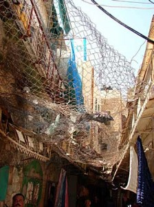 Nets to stop garbage thrown down by Israeli settlers in central Hebron
